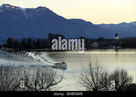 View across the Chiemsee to Fraueninsel and the Bavarian Alps Chiemgau Upper Bavaria Germany - Stock Photo