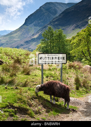 Buttermere, Lake District, UK with village road sign - Stock Photo
