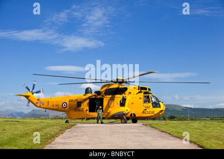 RAF Search and Rescue Sea King helicopter and crew in pre flight preparations The Lake District England UK - Stock Photo