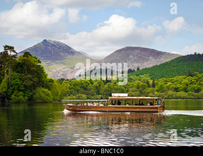 Keswick Launch on Derwentwater lake with Cat Bells, Causey Pike and Barrow mountains, The Lake District, UK - Stock Photo
