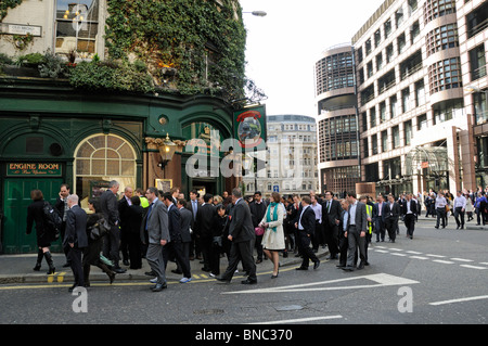 People evacuated from a building near Liverpool Street Station London England UK - Stock Photo