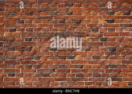 Red Brick Wall. A section of a red or orange brick wall. Good for backgrounds. - Stock Photo