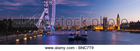 Panoramic view of the London Eye and The Houses of Parliament at night, London, UK. - Stock Photo