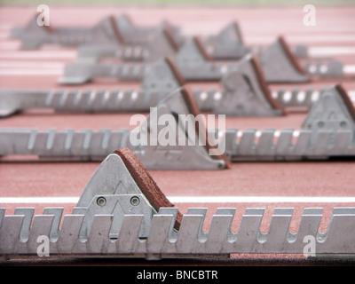 Closeup shot of starting blocks on racing track - Stock Photo