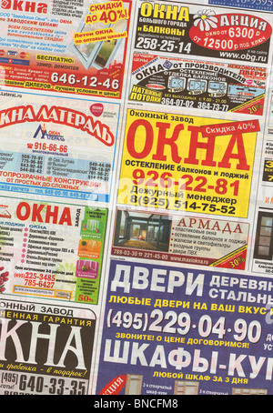 Russian business ads in free newspaper (vertical series in high resolution) - Stock Photo
