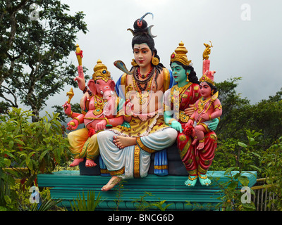 Colourful gods family group sculpture at Hindu temple on Penang hill, Penang, Malaysia - Stock Photo