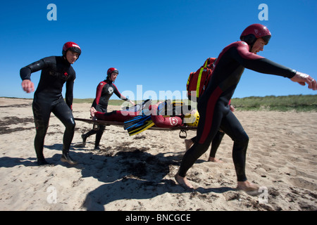 Training of the 'SNSM' lifeguards (French equivalent of RNLI in UK) : victim carried on a stretcher - Stock Photo