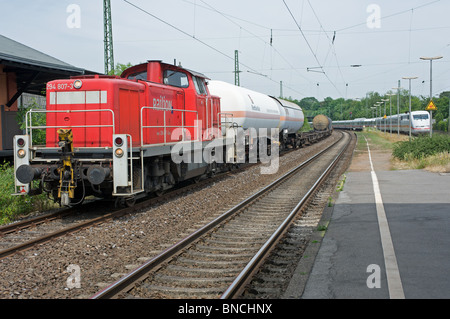 Freight train being held to allow high speed express train to pass, Leichlingen, North Rhine-Westphalia, Germany. - Stock Photo