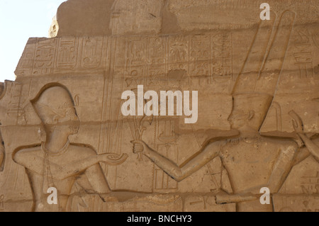 Ramesseum. Relief depicting the pharaoh making an offering to the god Amon. Egypt. - Stock Photo