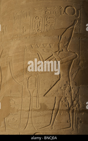 Ramesseum. Relief depicting the pharaoh making an offering to the gods.  Egypt. - Stock Photo
