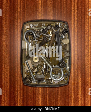 A box of saved nuts, bolts and screws - Stock Photo