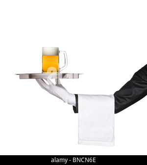 Butler holding a tray with a beer glass on it - Stock Photo