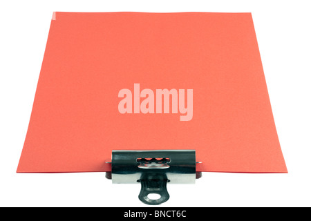 Sheets of red A4 paper and bulldog clip - Stock Photo