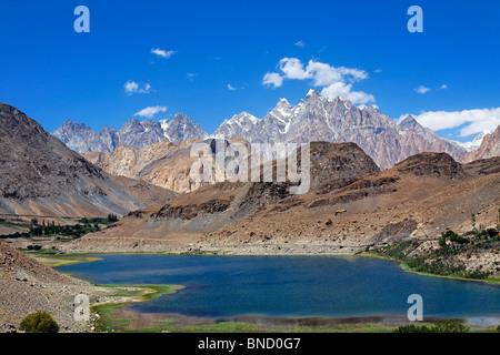 Borith Lake and mountains, Passu, Hunza Valley, Karakorum, Pakistan - Stock Photo