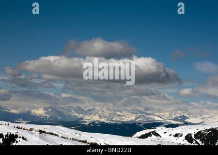Cumulus cloud passing over The Alpe De Siusi Ortisei  Val Gardena Dolomites - Stock Photo