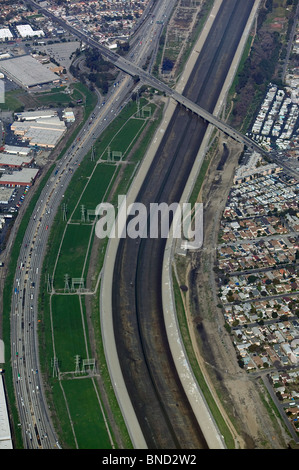 aerial view above power transmission line easement flood control creek easement Los Angeles California - Stock Photo