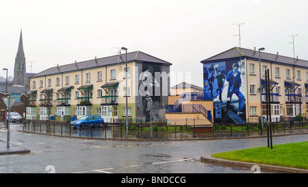 Murals on the walls of houses in the Bogside area of Derry, Northern Ireland - Stock Photo