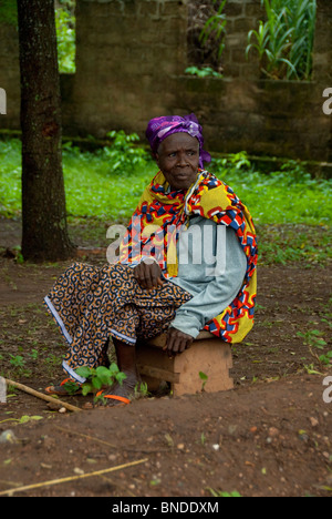 Africa, Togo, Kpalime Valley. Rural Togolese village. Colorful old woman in typical attire. - Stock Photo
