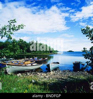 Fishing boats on the shore of 'Lough Corrib' lake, Connemara, County Galway, Republic of Ireland, Europe - Stock Photo