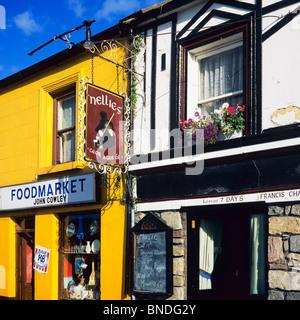'John Cowley' foodmarket and 'Francis Chambers' pub and restaurant, Westport, County Mayo, Republic of Ireland - Stock Photo