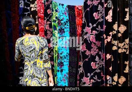 Colourful displays in the Fabric Market, Sunday Market, Ashgabat, Turkmenistan - Stock Photo