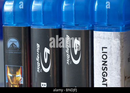 row of blu-ray dvd video cases stored in a home movie library in the uk - Stock Photo
