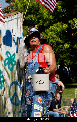 Man with Jug of Moonshine on Hillbilly Float in Oldest Continuous Independence Day Parade in America in New Pekin, - Stock Photo