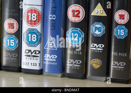 row of dvd video cases showing a range of BBFC and irish film censors office classification notices from the uk - Stock Photo