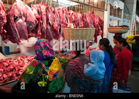 Customers at a butcher's shop, Totonicapan, Guatemala - Stock Photo