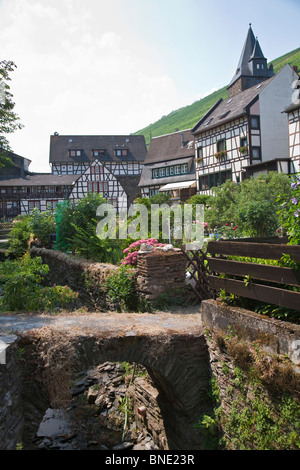 Small bridge leading to wood-framed buildings. Bacharach, Germany. Mittelrhein - Stock Photo