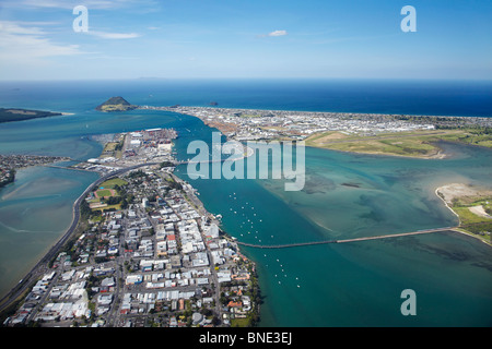 Tauranga, Tauranga Harbour, and Mount Maunganui (in distance), Bay of Plenty, North Island, New Zealand - aerial - Stock Photo