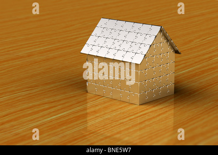 House made out of puzzle pieces on wooden surface - Stock Photo