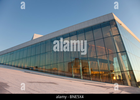 Oslo opera house bathed in sunlight in winter - Stock Photo