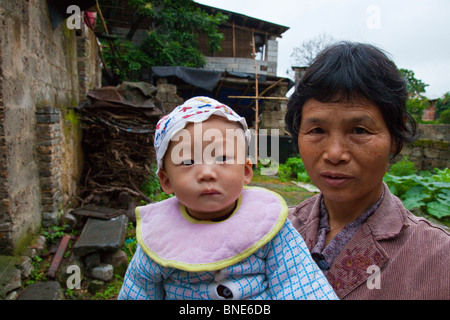 Grandmother and baby in Fuli Town near Guilin and Yangshuo in Guangxi Province, China - Stock Photo
