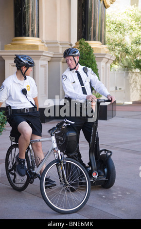 two andrews security guards on duty outside caesars palace shopping mall casino hotel in las vegas - Andrews International Security Guard
