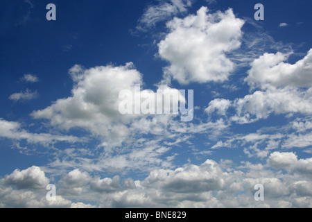 Fluffy White Clouds in a Blue Sky - Stock Photo