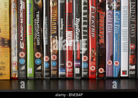 row of dvd video cases on a shelf showing a range of BBFC and irish film censors office classification notices from - Stock Photo