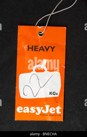 easyjet overweight heavy 22 kgs flight luggage label - Stock Photo