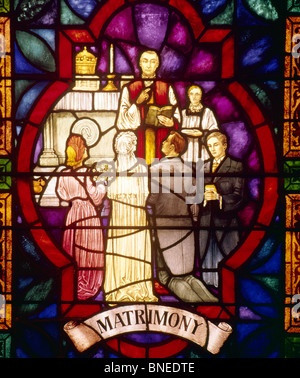 USA,  New York City,  Our Lady of Pompeii Church,  Stained glass depicting matrimony - Stock Photo