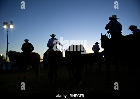 Cowboy members of PRCA at backstage for rodeo event in Bridgeport, Texas, USA - Stock Photo