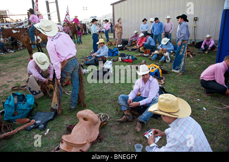 Cowboy members of  PRCA waiting backstage for  rodeo event  in Bridgeport, Texas, USA - Stock Photo