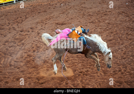 Horse trying to throw rodeo cowboy member of PRCA from its Back in Smalltown Bridgeport, Texas, USA - Stock Photo