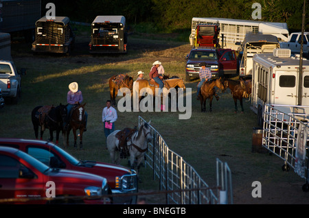 Cowboy members of PRCA preparing backstage for rodeo event in Bridgeport, Texas, USA - Stock Photo