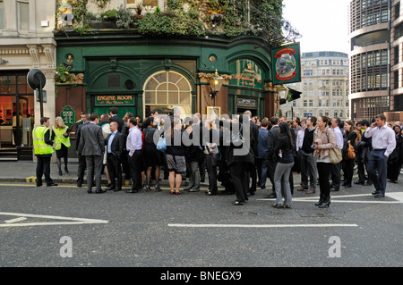 Crowd of people evacuated from a building near Liverpool Street Station London England UK - Stock Photo