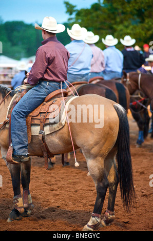 Cowboy members of PRCA riding horses  at rodeo event in Bridgeport, Texas, USA - Stock Photo