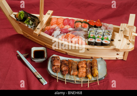 Japanese Food on a Plate, Sushi Meal on Boat, with Grilled Skillers on a Plate - Stock Photo
