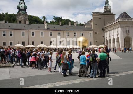 Salzburg Austria EU Children on a school trip lined up in Kapitel Platz - Stock Photo
