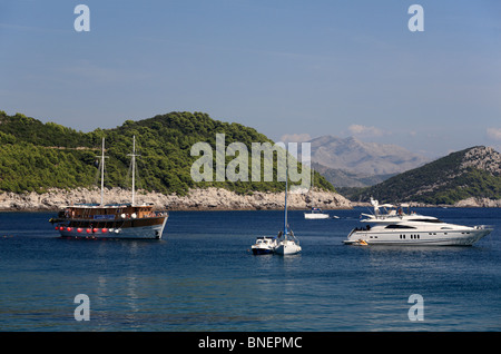 Gulet holiday charter boat in Sunj bay with the best beach on Lopud one of the Elaphite Islands near Dubrovnik Croatia - Stock Photo