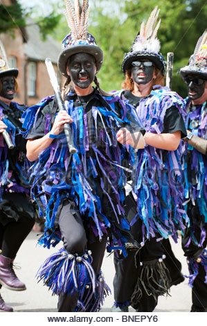 Women with blacked up faces Morris dancing at Skenfrith village fun day 2010. Woman morris dancer, UK. Black face - Stock Photo