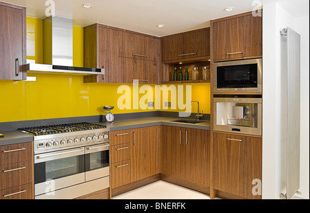 Shot of a Brand New Contemporary Walnut Kitchen - Stock Photo